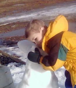 Justin, loving on the Snow Penguin.