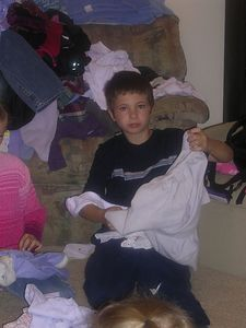 Jon folding laundry