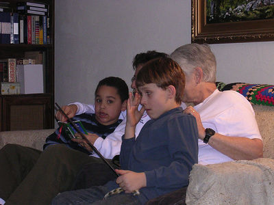 Priscilla and Gerry, reading to Andre and TJ