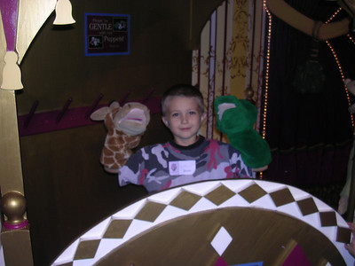 Justin in the puppet theater