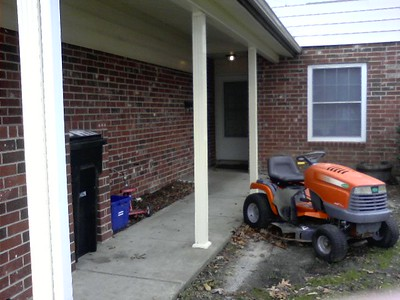 Our front entrance, complete with the riding mower that we have no where else to store
