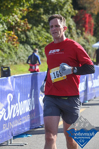 crossing the finish of the snohomish river run (marathon).  did this on a whim, borne the day before.  not my fastest day, but stayed on plan, and got it done.