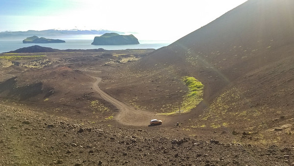 the center of eldfell's crater is marked with the cross.  that's eyjafjallajokull (whose 2010 eruption disrupted transatlantic travel in a big way) off in the distance.