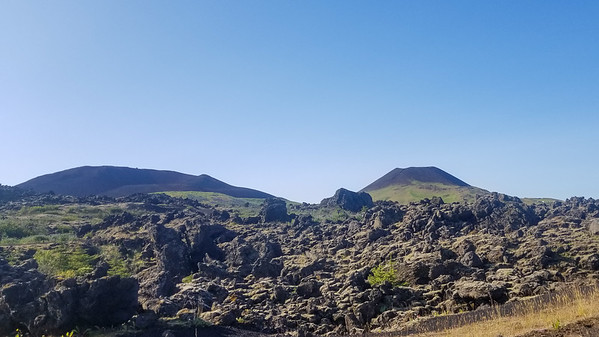 volcanic twins, eldfell and helgafell, across the lava.