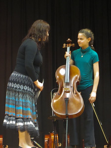 r and her cello teacher setting up for the recital