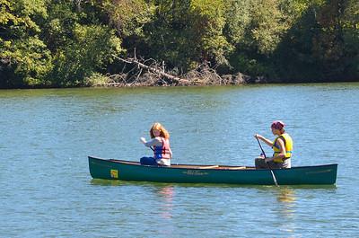 piloting a canoe at camp