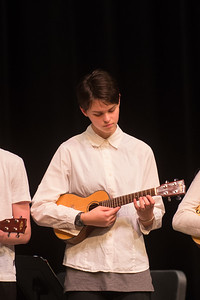 performing with the ukelele esemble at the school sharing assembly
