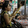 Spiral potato on a stick--typical might market fare in Xi'an. June 25, 2017