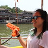 Piloting our own electric boat at Beihai Garden--originally built in the 11th century, Beihai is a public park and former imperial garden. The plastic pistol makes a quacking sound! June 19, 2017