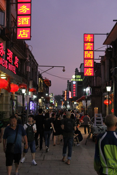 First night in China--the Qian Men hutong (or neighborhood) sports an eerie purple sky. Lots of people are out for shopping and street food. June 18, 2017