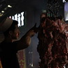 Carving meat, the night market in Xi'an. June 25, 2017
