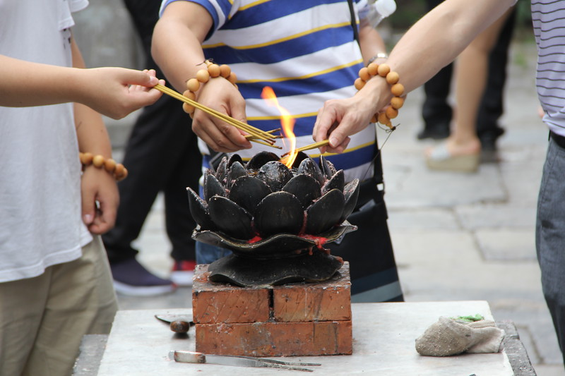 Observant Buddhists among the tourists light incense at the Shaolin Zhongyue Temple. June 21, 2017