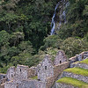 A waterfall spills down the mountainside at the ruins of Wiñay Wayna, Peru.