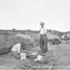 Peabody Curator Fred Johnson supervises excavation of the Hornblower shell heap, Martha's Vineyard, 1936.