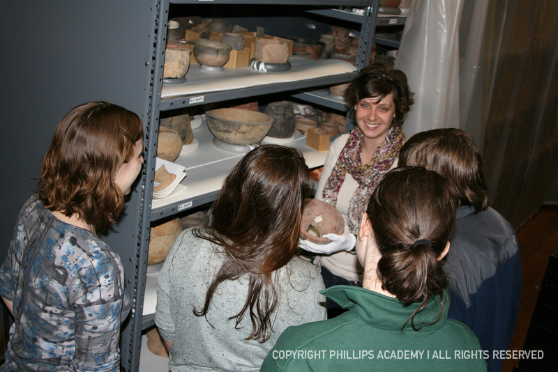 Museum Educator Lindsay Randall shares Peabody Museum artifacts with students.