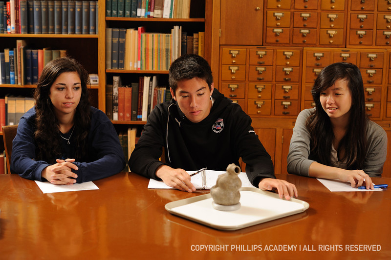 Phillips Academy students examine a pottery vessel from the southeastern United States.