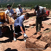 Laying adobe bricks to help conserve the convent walls at Pecos National Historical Park.