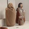 Maxine Toya's figurines dry before firing.