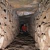 Mark Cutler navigates the narrow passages of an ancient aqueduct.
