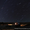 Star trails form over Eduardo's home during a time lapse photograph.
