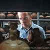 Spanish Instructor and HUACA co-director Mark Cutler examines ceramic vessels at the Larco Herrera Museum in Lima, Peru.