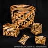 Chitimacha cane baskets; river cane, dyes; St. Mary's Parish, Louisiana; c. 1900<br /> Five distinctive double-woven Chitimacha split cane baskets exhibit typical motifs and forms. Vegetable and mineral dyes are used to achieve the black, red, and yellow colors.