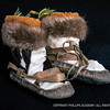 Mukluks; seal skin, fur; Unalakleet, Alaska; 20th century<br /> This pair of Inuit children's mukluks, or kamiks, was made by Anna Etegeak. Perfect for walking on snow or ice, these would deteriorate quickly if worn on sand.