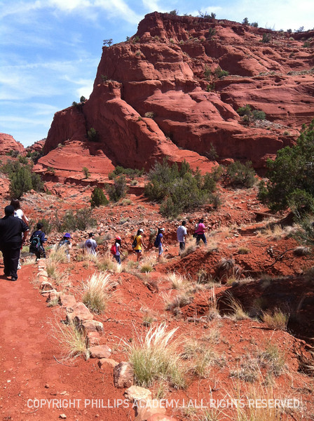 Students hike through Red Rocks at Jemez Pueblo learning about flora, fauna, and  geological history of the area.