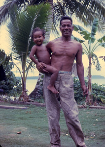 Wisim, our host on Udot island and his son Whisper.