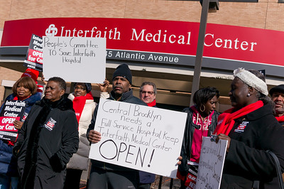 People assembled for a press conference in front of Interfaith Medical Center on Atlantic Avenue.