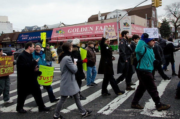 The marchers reach their destination: Gold Farm market at East 4th Street and Church Avenue. Councilman Brad Lander at left in black coat marched along and spoke at the rally.