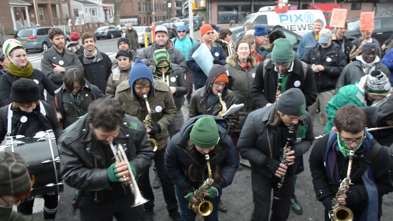 Press PLAY (>) above for a video of the Rude Mechanical Orchestra at today's support rally for Golden Farm workers.
