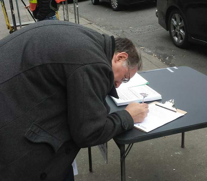 Signing the BFP petitions to Congress and President Obama.