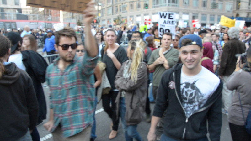 Press PLAY to see a short video of people marching past our Brooklyn For Peace banner being held aloft at Foley Square.