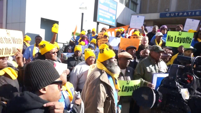 "Press PLAY ► (above) to see a short video.<br /> <br /> ""Save Downstate"" is chanted by the rally participants."