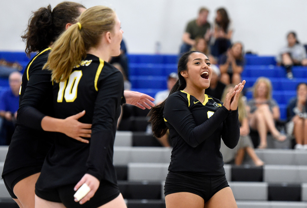 . Prospect Ridge Academy\'s Destiny Castro, right, celebrates a point during a volleyball match against Peak to Peak on Tuesday in lafayette. More photos: www.BoCoPreps.com Jeremy Papasso/ Staff Photographer/ Sept. 12, 2017