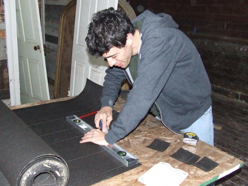 Steven cutting tar paper