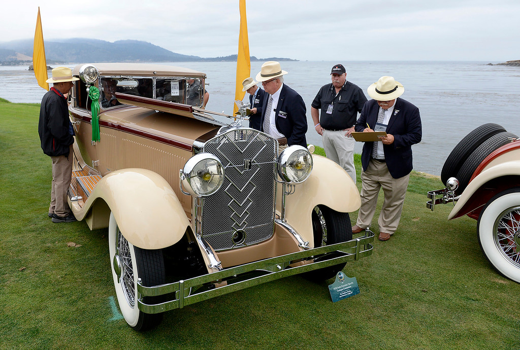 . Judges look over a 1928 Isotta Fraschini Tipo 8A Castagna Commodore while on display on the Pebble Beach Golf Links during the Pebble Beach Concours d\'Elegance on Sunday, Aug. 20, 2017.  (Vern Fisher - Monterey Herald)