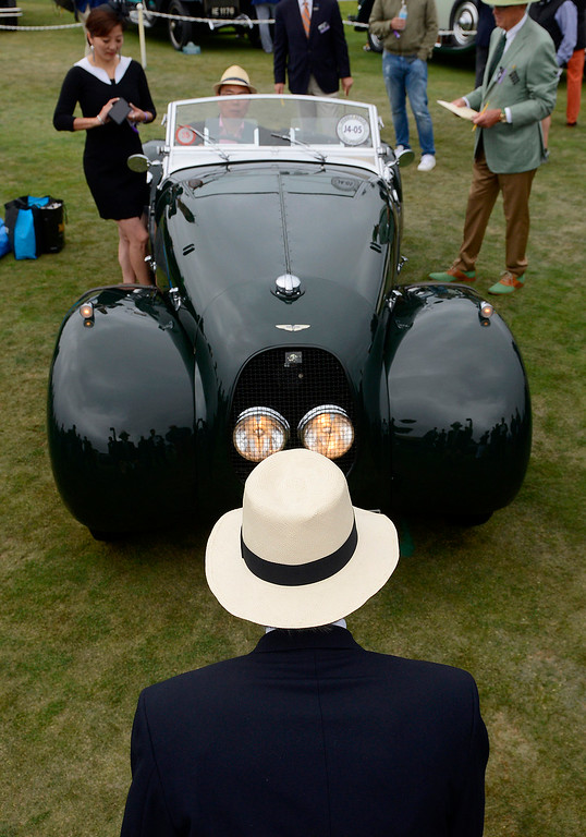 . A judge looks at a 1940 Aston Martin Type C Speed Model at the Pebble Beach Golf Links during the Pebble Beach Concours d\'Elegance on Sunday, Aug. 20, 2017.  (Vern Fisher - Monterey Herald)
