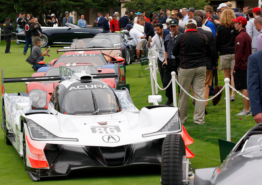 . Various race cars were on display on the practice green of the Pebble Beach Golf Links during the Pebble Beach Concours d\'Elegance on Sunday, Aug. 20, 2017.  (Vern Fisher - Monterey Herald)
