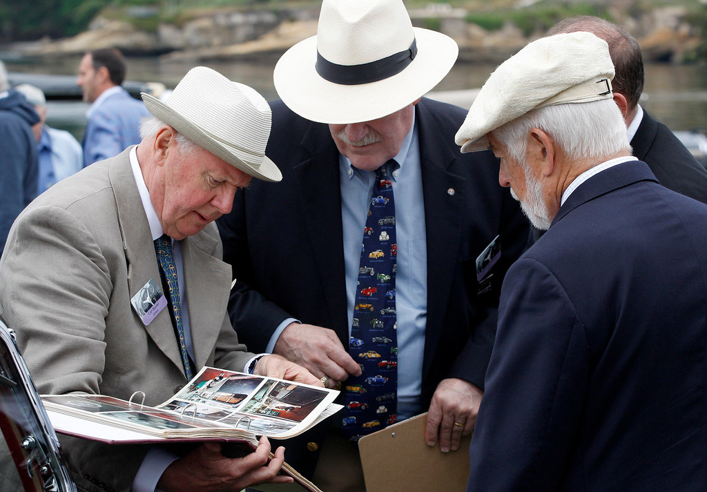 . John Adamick (left) talks with judges while viewing his 1909 De Dion-Bouton BV Type de Course at the Pebble Beach Golf Links during the Pebble Beach Concours d\'Elegance on Sunday, Aug. 20, 2017.  (Vern Fisher - Monterey Herald)