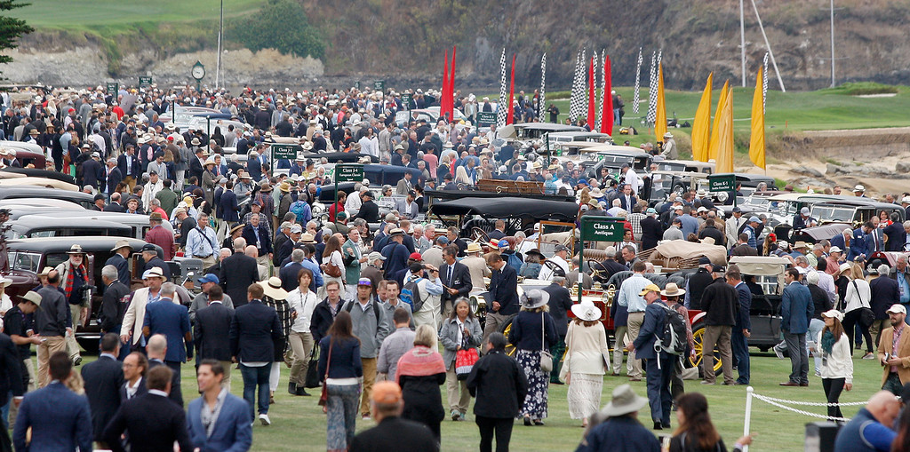 . A crowd of classic car enthusiasts on the 18th hole fairway of the Pebble Beach Golf Links during the Pebble Beach Concours d\'Elegance on Sunday, Aug. 20, 2017.  (Vern Fisher - Monterey Herald)