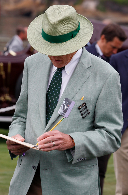 . Concours judge Jim Hull takes notes while judging classic cars at the Pebble Beach Golf Links during the Pebble Beach Concours d\'Elegance on Sunday, Aug. 20, 2017.  (Vern Fisher - Monterey Herald)
