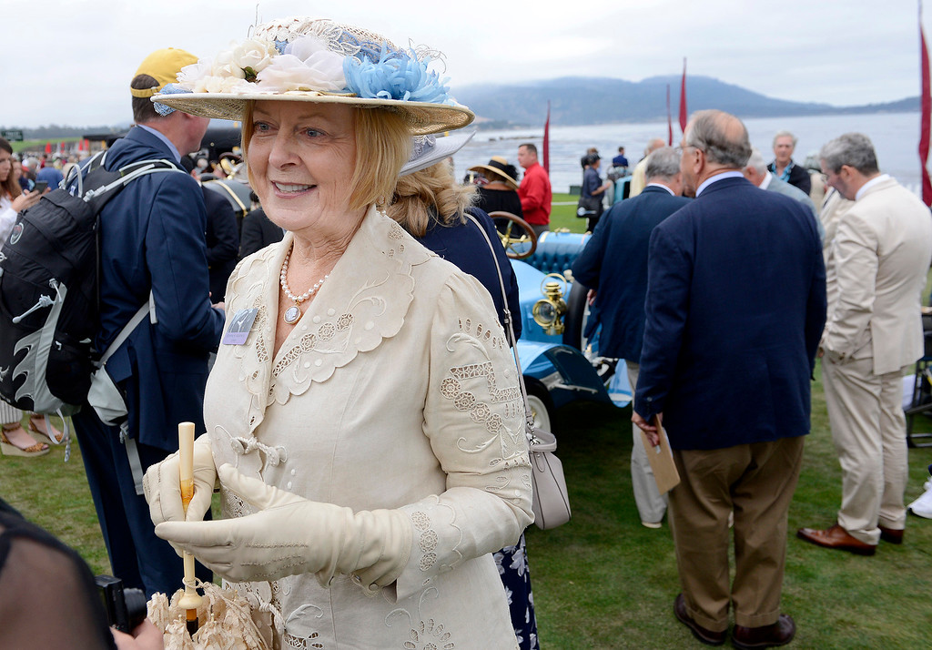 . Bonnie Adamick dresses in period clothing while her husband John Adamick displays their 1909 De Dion-Bouton BV Type de Course on the Pebble Beach Golf Links during the Pebble Beach Concours d\'Elegance on Sunday, Aug. 20, 2017.  (Vern Fisher - Monterey Herald)