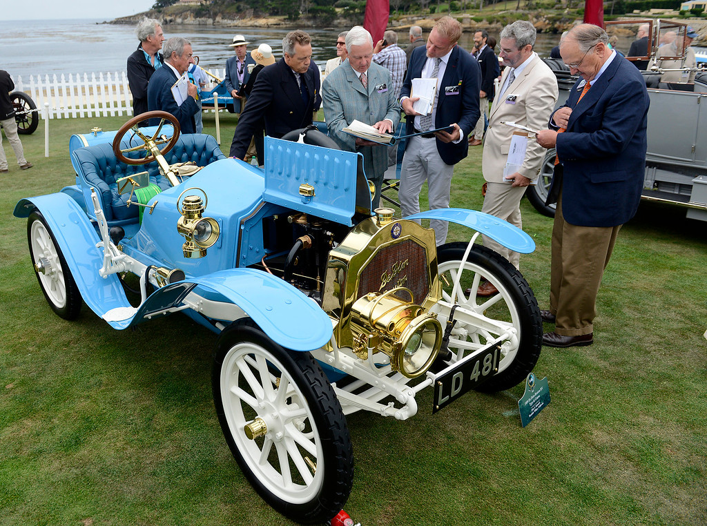 . John Adamick (center) talks with judges about his 1909 De Dion-Bouton BV Type de Course on the Pebble Beach Golf Links during the Pebble Beach Concours d\'Elegance on Sunday, Aug. 20, 2017.  (Vern Fisher - Monterey Herald)