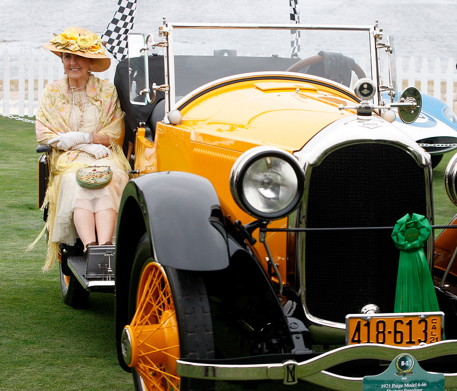 . Jo Ann Martindale from Santa Cruz dressed in period clothing for the ride in their 1921 Paige Daytona Boatail Speedster at the Pebble Beach Concours d\'Elegance on Sunday, August 26, 2018.  (Vern Fisher - Monterey Herald)