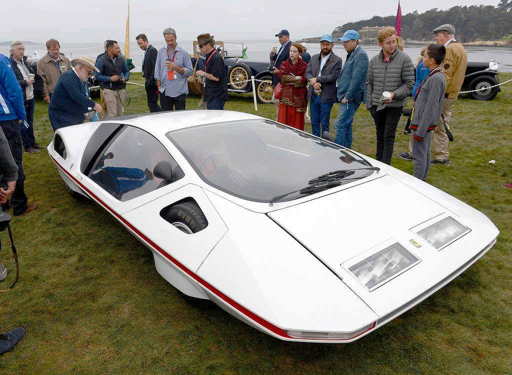 . People gather around a 1970 Ferrari 512 S Modulo Pininfarina Coupe at the Pebble Beach Concours d\'Elegance on Sunday, August 26, 2018.  (Vern Fisher - Monterey Herald)