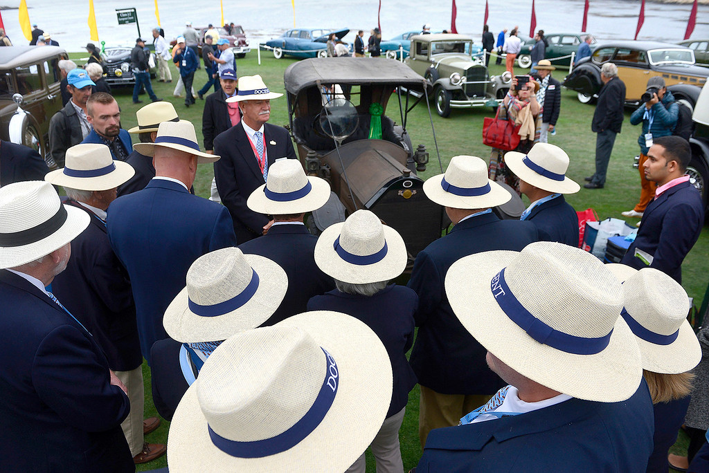. Concours judges gather around a 1910 Regal Model N Underslung Fisher Roadster at the Pebble Beach Concours d\'Elegance on Sunday, August 26, 2018.  (Vern Fisher - Monterey Herald)