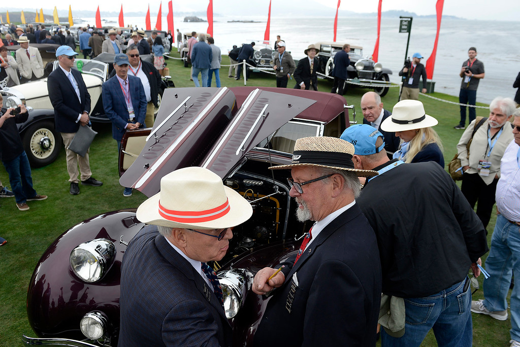 . Judges discuss a 1937 Delahaye 135 M Chapron Convertible Coupe at the Pebble Beach Concours d\'Elegance on Sunday, August 26, 2018.  (Vern Fisher - Monterey Herald)