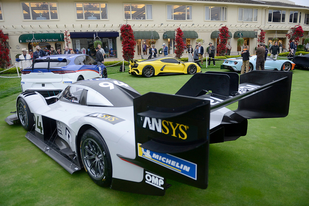 . Concept cars with race cars were on display on the practice green at the Pebble Beach Golf Links during the Pebble Beach Concours d\'Elegance on Sunday, August 26, 2018.  (Vern Fisher - Monterey Herald)